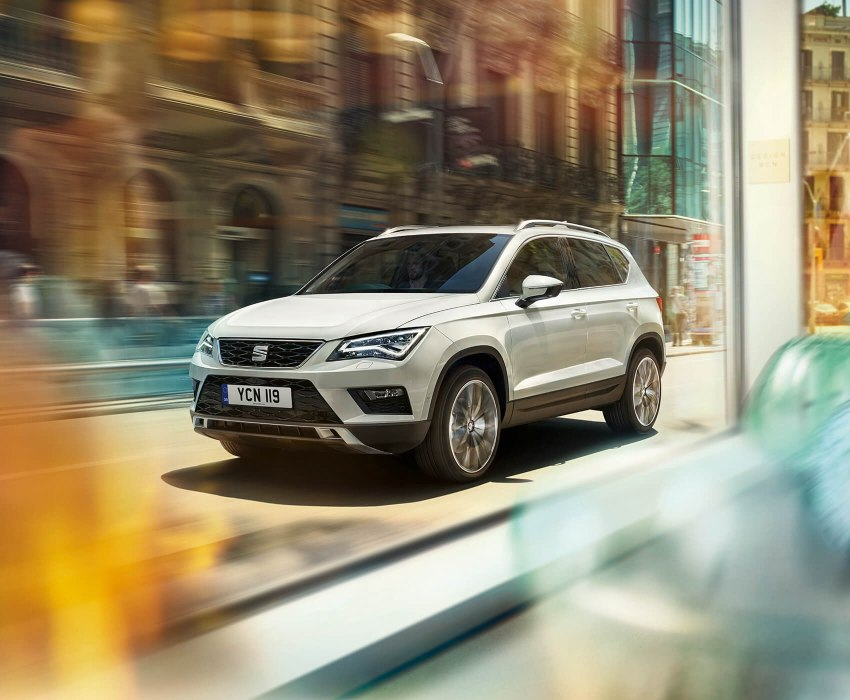 SEAT Ateca - Car driving down the road